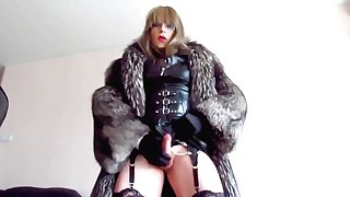 Transvestite Mistress in fur cumming in cup