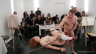 Extreme BDSM fetish in kinky orgy for the redhead