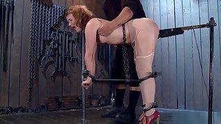 Redhead slut toyed in device bondage