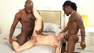 Black studs fuck a twink and flood his ass with jizz