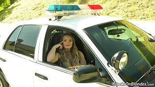 Hot porn actress Cali Carter gives an interview sitting in a police car