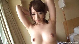 Solo Asian model drops her clothes to tease with her puss and ass