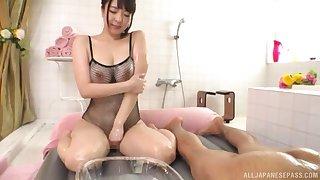 Oiled up Japanes at hand fishnets Mashiro An cums while riding bushwa