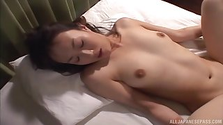 Japanese brunette plays with her tits increased by pussy before a light of one's life